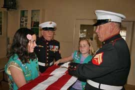 Flag folding with girl scouts
